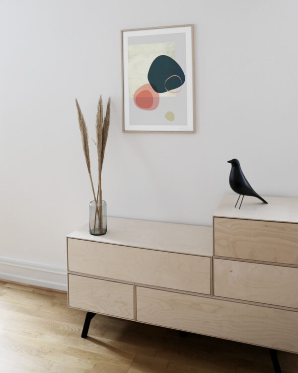 furniture in wood and a oak frame on the wall with poster
