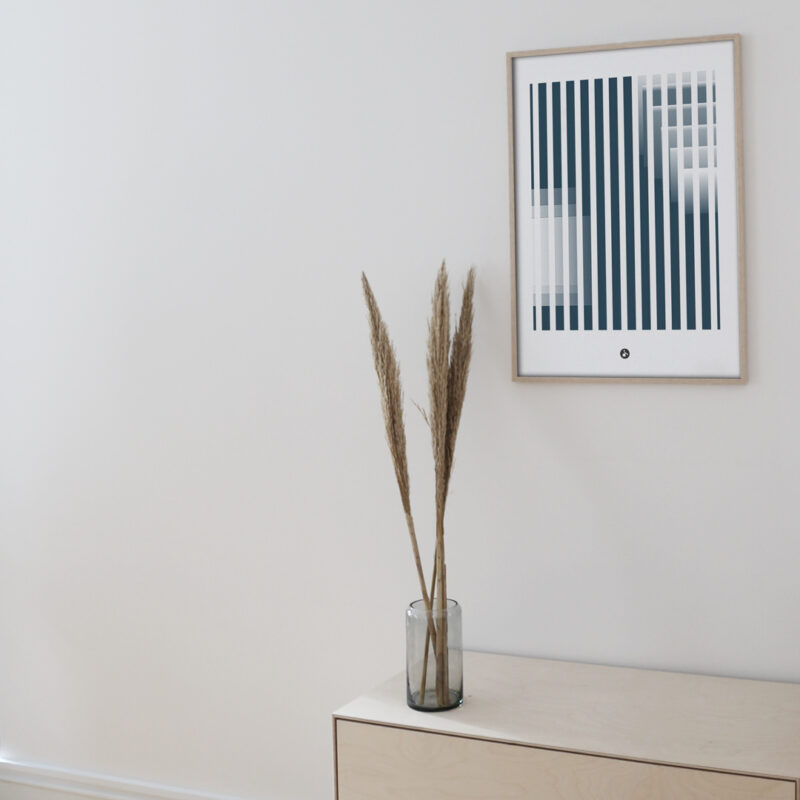 a thin oak frame hanging on a white wall with the art print inside with the title; Echo 01