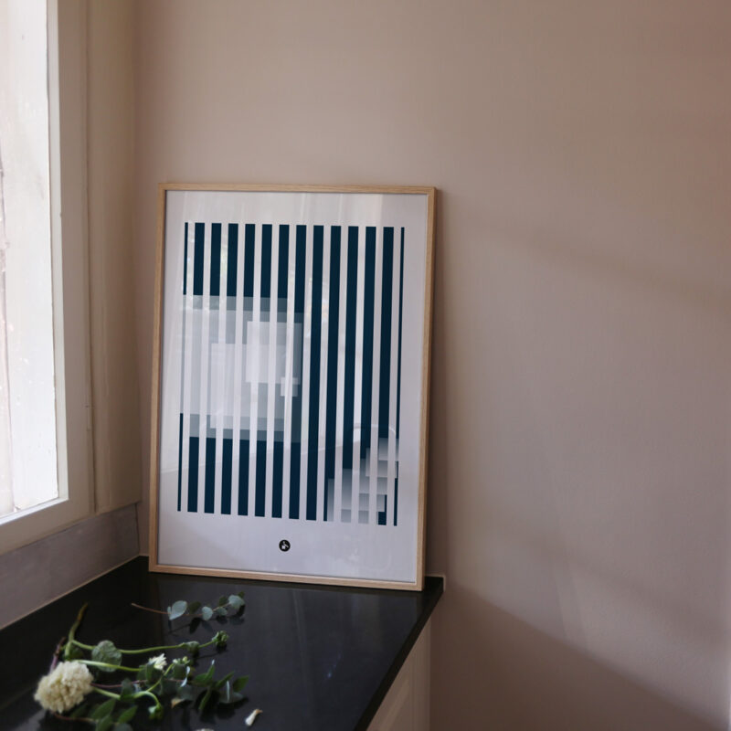 a frame with an art print with the title; Echo 02 standing on the kitchen table