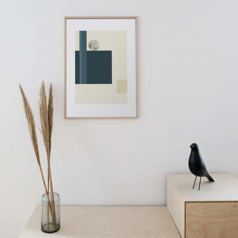 A thin oak frame hanging on a white wall with the art print inside with the title; Blue Notes 02